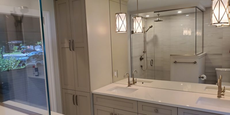 bathroom with double-sink vanity and counter-to-ceiling mirror